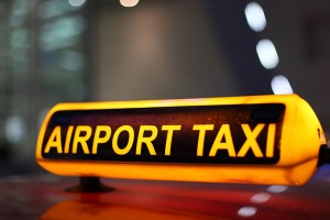 Airport Taxi sign illuminated at night